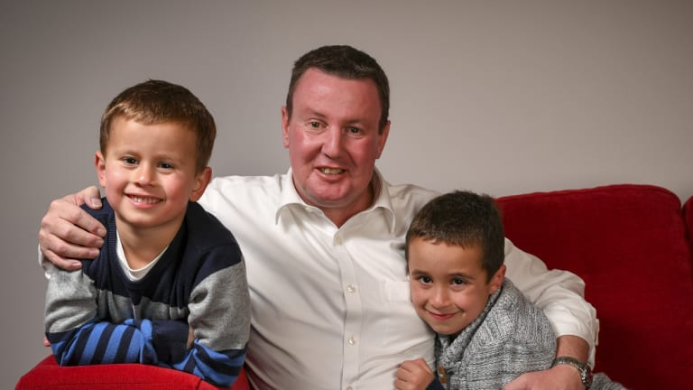 Karl Meban - seen here with his sons Adam and Louis - has dodged the deadly odds of oesophageal cancer.