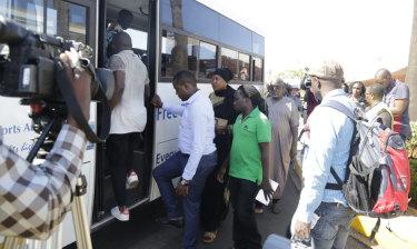 Relatives of the victims board a bus at Jomo Kenyatta International Airport, Nairobi.