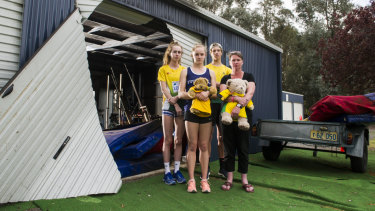 Woden athletics club users Grace Brennan, Caitlin Hanna, Erek Lukowski and Woden Thunder Little Athletics Club Secretary Mel Harding are disappointed to see a shed containing sports equipment at the Woden Athletics Park destroyed due to arson.
