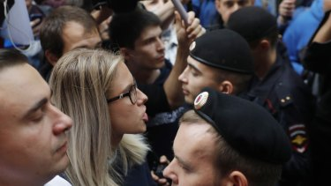 Russian opposition candidate and lawyer at the Foundation for Fighting Corruption Lyubov Sobol, centre, stands in front of police during a protest in Moscow.
