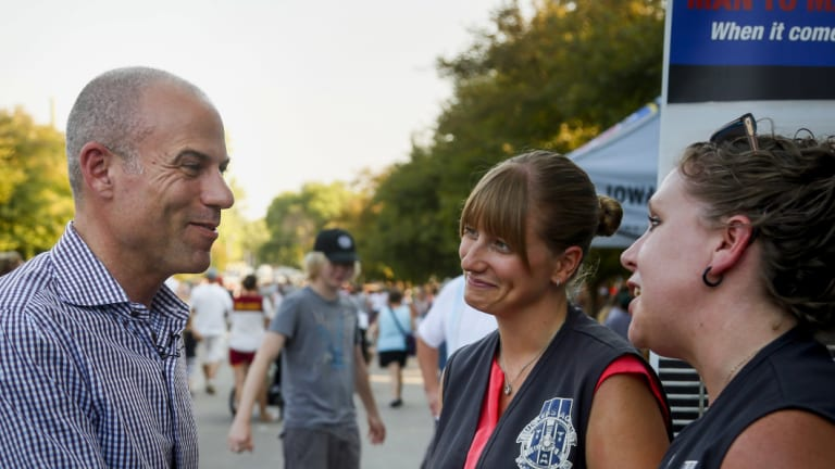 Michael Avenatti shakes hands at the Iowa State Fair in Des Moines, Iowa.