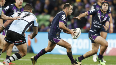 Mr Consistency: Cameron Smith runs the ball in his 400th NRL match.