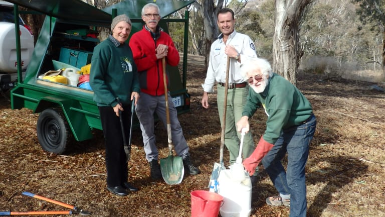 Sonja Lenz, Martin Chalk and Kevin McCue are part of the Gudgenby Bushies volunteers group, pictured with Brett McNamara, ACT Parks and Conservation manager Namadgi National Park.
