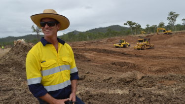 Greening Australia's Damon Telfer oversees construction works to repair tunnel-erosion at Strathalbyn behind Townsville.