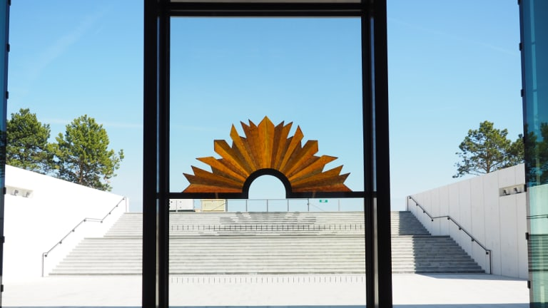 The rising sun sculpture at the new World War One memorial in France. Canberra sculptor Dan Lorrimer made the supporting bar and Lisa Cahill created the glassworks.