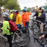 Climate activists use bikes to block morning traffic