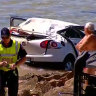 Three people injured after car drives off cliff onto Newcastle beach