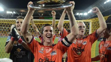Matt McKay celebrates winning the A-League grand final in 2011.