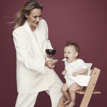 Emma Isaacs with her sixth child, Louis; she live-streamed his home birth last year, despite many advising against it.