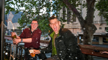 Managers at The Duke, Andy O'Brien and Tim Hale celebrates the good news from the Premier Daniel Andrews last night.