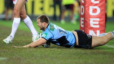 Trent Merrin scores under the posts in Sydney.