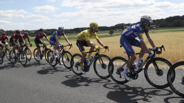 France's Julian Alaphilippe wearing the leader's yellow jersey on Bastille Day.