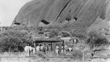In century heat the 1981 Azaria Chamberlain inquest takes place under shade where the Chamberlains camped. In the foreground is the newly constructed dingo fence.