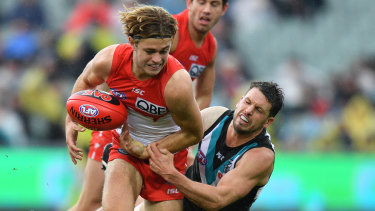 James Rowbottom is tackled during Sydney's loss to Port Adelaide.