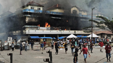A local market is seen burning during a protest in Fakfak, Papua province.
