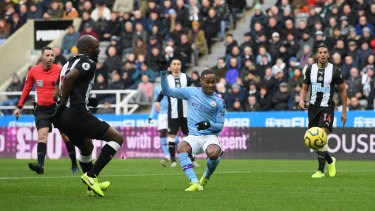Raheem Sterling scores the opening goal during City's clash with Newcastle United in Newcastle upon Tyne.