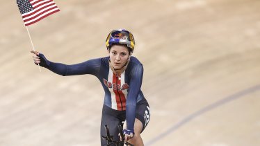 Chloe Dygert celebrates winning the women's individual pursuit and setting the world record.