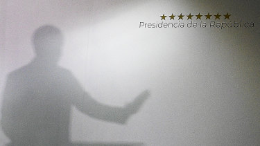 The shadow of Venezuela's Opposition Leader Juan Guaido is projected on a wall during a press conference at his private office in Caracas on Sunday.