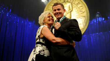 High point: Todd Carney with mother Leanne after his Dally M medal win in 2010.