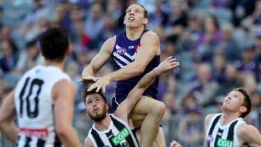 Nat Fyfe jumps high at Optus Stadium last season ... the Dockers captain wants to make the club's new home ground more of a fortress in 2019.