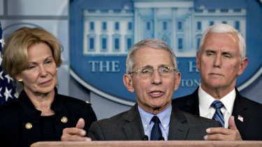 Anthony Fauci, director of the National Institute of Allergy and Infectious Diseases, centre, addresses the media alongside Vice-President Mike Pence, right, and Deborah Birx, coronavirus response coordinator, on Monday.