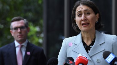 Battle lines: NSW Premier Gladys Berejiklian  and Treasurer Dominic Perrottet, who revealed in April that he had been working on a cabinet proposal to halt public servants' pay rises for 12 months.