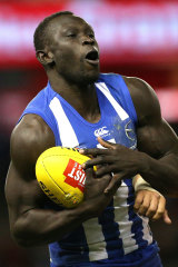 Second chance: Majak Daw takes a mark for the Kangaroos.