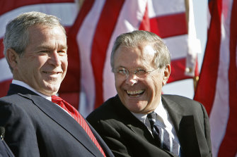Then US president George W Bush, left, shares a laugh with his secretary of defence Donald Rumsfeld in 2006.