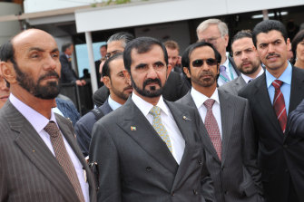 Sheikh Mohammed (centre) at the Melbourne Cup in 2010.