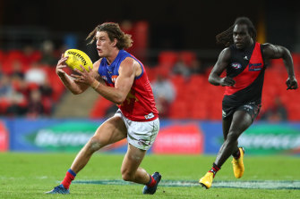 The Lions' Jarrod Berry steams clear of Bomber Anthony McDonald-Tipungwuti.