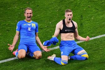 Artem Dovbyk (right) celebrates his late winner for Ukraine.