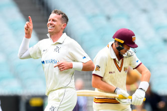 Peter Siddle, left, celebrates after taking the wicket of Marnus Labuschagne.