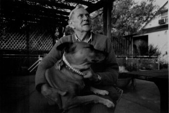 Patrick White at his Cenntenial Park home with his dog Eureka in 1984.
