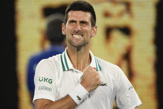 Novak Djokovic celebrates after defeating Russia's Aslan Karatsev in their semi-final.