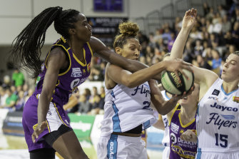 Melbourne Boomers centre Ezi Magbegor (left) takes on WNBA import Mercedes Russell (middle) in the WNBL. The pair will be teammates with Seattle Storm in the WNBA.