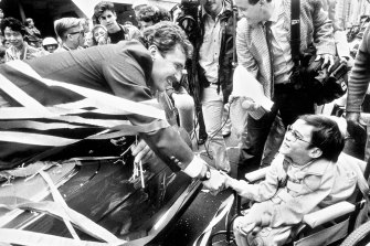 Allan Border greets a fan at the ticker tape parade held in Sydney a few days later.