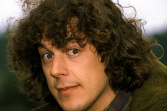 Alan Davies, pictured in 1996, was not allowed to mourn his mother who died when he was only six.