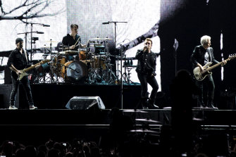 U2 opened the show with all four members performing on a runway deep into the crowd.