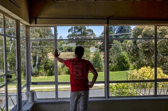 A resident of Borlase Street, Yallambie, looks over Borlase Reserve.