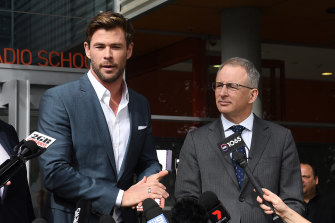 Federal arts minister Paul Fletcher (right) with actor Chris Hemsworth at the July 2019 announcement that a new Marvel movie was set to film in Sydney.
