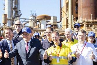 Prime Minister Scott Morrison takes centre stage at Ampol's Lytton refinery on Monday.