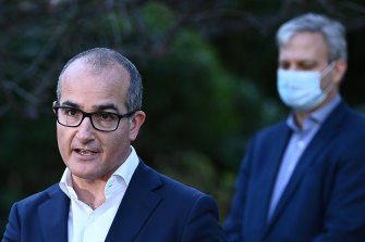 Victoria's acting Premier, James Merlino, centre, has levelled blame for the state's latest outbreak on the federal government.