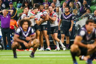 Melbourne Storm players react to a golden-point loss to the Roosters this year.