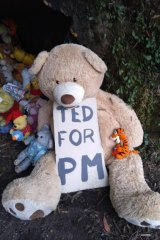 An ambitious teddy bear at Pooh's Corner.