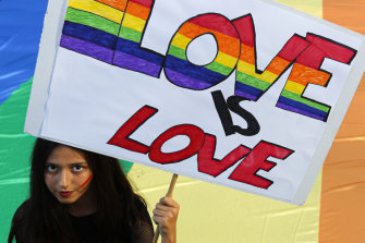A participant holds a banner during the annual gay pride march in Belgrade, Serbia, which was disrupted by anti-gay protesters.