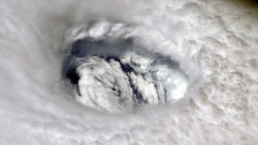 The eye of Hurricane Dorian over the Bahamas on Monday. Dorian has rebuilt into a Category 3 storm.