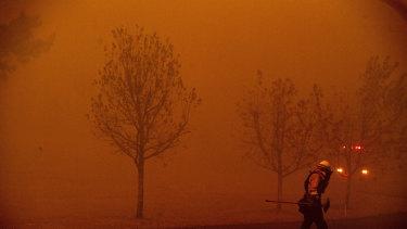A firefighter battles a wildfire in Healdsburg, California, last weekend.