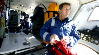 Specialist paramedic Harry Gatt (right), pictured in a helicopter in 2004.