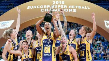Lightning players celebrate winning the 2018 Super Netball title.