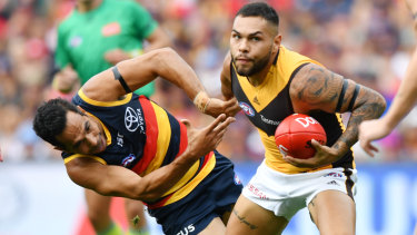 Poise: Hawk Jarman Impey controls possession under pressure from Adelaide's Eddie Betts.